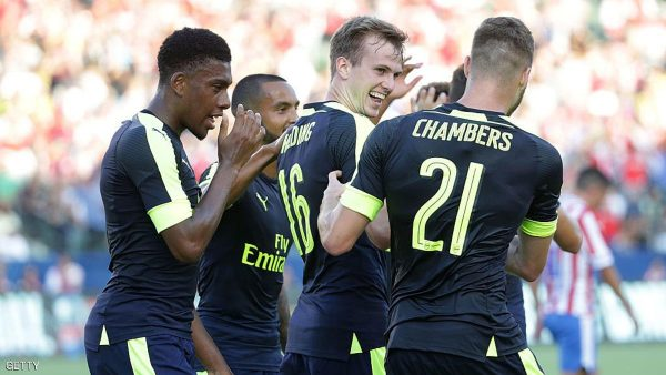 CARSON, CA - JULY 31:  (L-R) Alex Iwobi #17, Theo Walcott #14, Rob Holding #16 and Calum Chambers #21 of Arsenal celebrate Holding's first half goal against Chivas de Guadalajara at StubHub Center on July 31, 2016 in Carson, California. Arsenal defeated Chivas de Guadalajara 3-1.  (Photo by Jeff Gross/Getty Images)